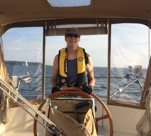 Julie at the helm on a summer day