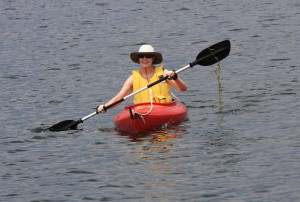 Julie in a kayak (with salad)