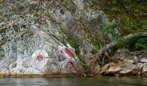 Red Right Returning painted on the rocks by GLCC members